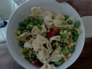 Dinner of tomato and partially thawed: edamame beans, corn, pasta